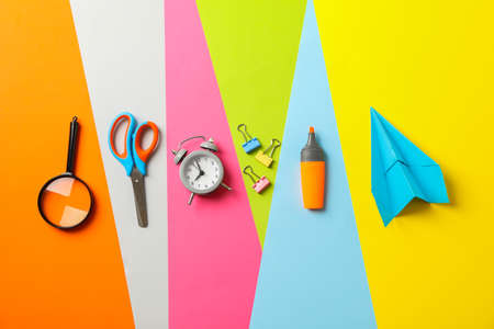 Flat lay composition with school supplies on multicolor background, space for text Stockfoto