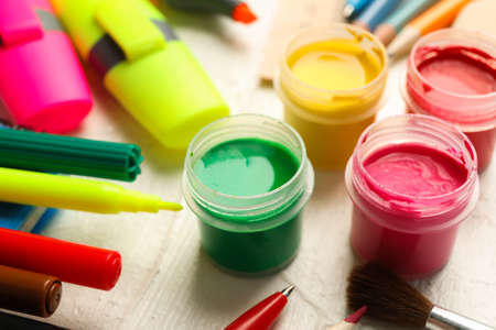 Drawing supplies on white wooden background, closeup