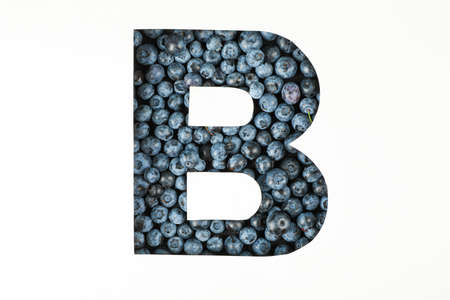 Letter B against blueberries backdrop isolated on white background