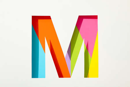 Multicolor letter M on white background, space for text