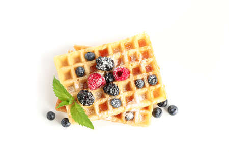 Belgian waffles with berries and mint isolated on white background Stock Photo