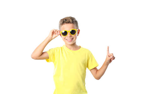Boy in yellow t-shirt with sunglasses isolated on white background