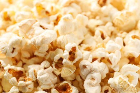 Delicious popcorn on whole background, close up