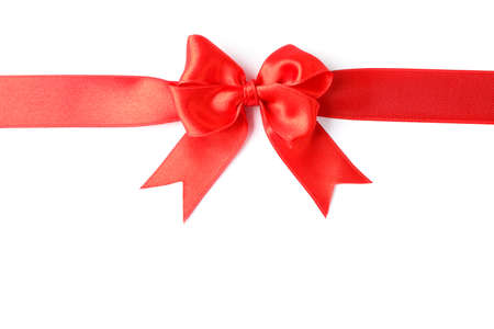 Red ribbon with bow isolated on white background. Gift concept Stock Photo