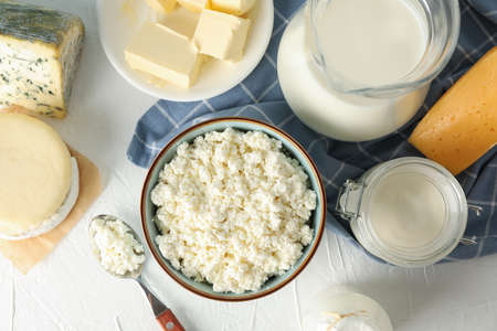 Different dairy products on white background, top view