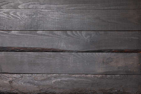 Dark wooden background. Texture for your design. Space for text 写真素材