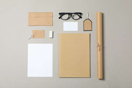 Mockup. Corporate stationery and glasses on grey background. Flat lay Stock fotó
