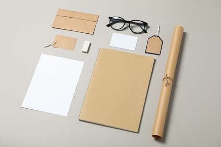 Mockup. Corporate stationery and glasses on grey background, copy space