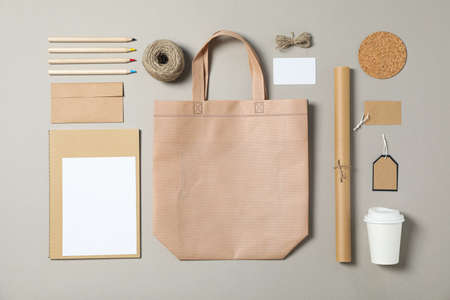 Mockup. Corporate stationery, tote bag and paper cup on grey background. Flat lay