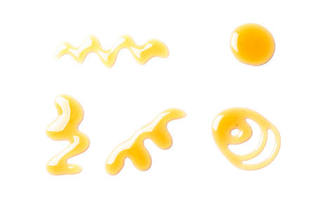 Sweet honey smears isolated on white background 写真素材