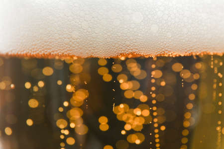 Beer and foam texture on whole background, close up