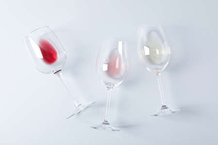 Flat lay. Glasses with different wine on grey background, copy space