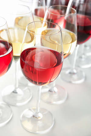 Glasses with different wine on white background, close up 写真素材