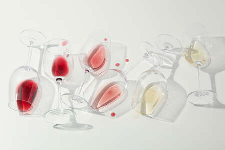 Flat lay composition. Glasses with different wine on white background