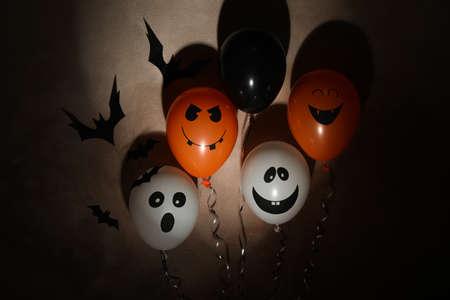 Different balloons on dark background. Halloween concept