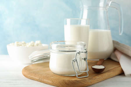 Fresh dairy products on white wooden table, copy space Reklamní fotografie