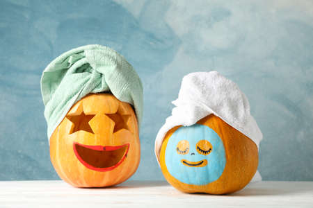 Funny pumpkins with towels on white background, space for text 스톡 콘텐츠