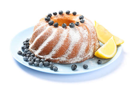Cake with powdered sugar, blueberry and lemon isolated on white background 版權商用圖片 - 130143280