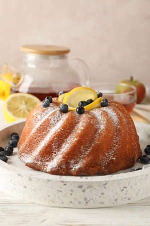 Cake with powder sugar and lemon on white background, space for text 版權商用圖片 - 130143284