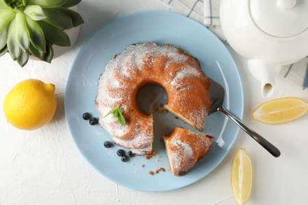 Cake with powdered sugar, blueberry and mint on white background, top view 版權商用圖片 - 130143396