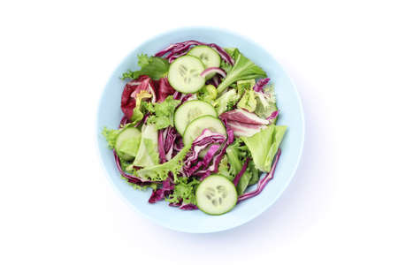 Plate with fresh salad isolated on white background