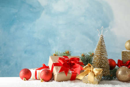 Presents and Christmas tree on decorated background, space for text