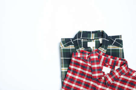 Different beautiful shirts on white background, copy space