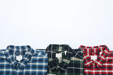 Flat lay with shirts on white background, copy space Stock fotó