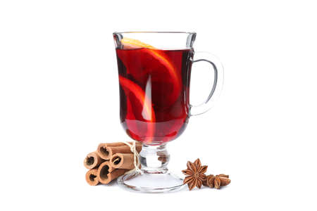 Glass of mulled wine with orange and cinnamon isolated on white background