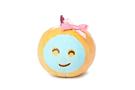 Pumpkin with facial mask and bow isolated on white background Stock Photo