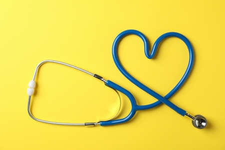 Stethoscope on yellow background, top view and space for text Zdjęcie Seryjne