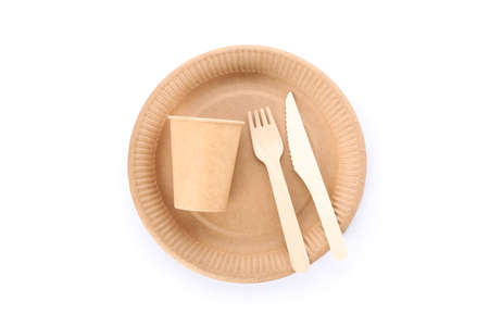 Eco - friendly plate with fork, spoon and cup isolated on white background. Disposable tableware 版權商用圖片