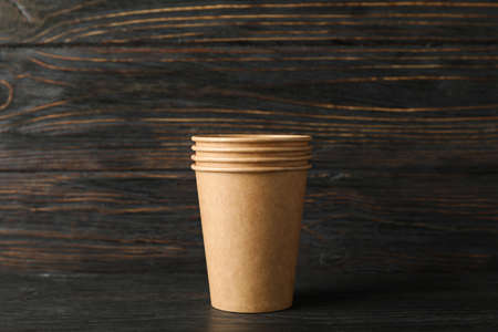 Eco - friendly paper cups on wooden background, space for text Stock fotó