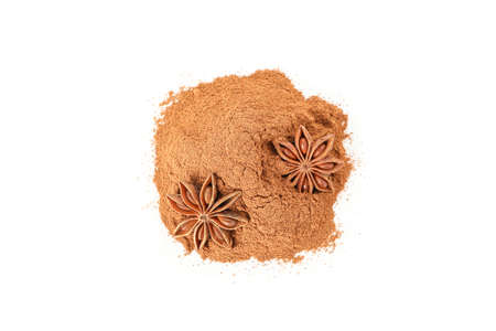 Cinnamon powder and fragrant anise isolated on white background