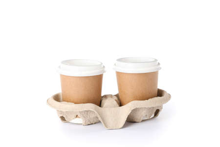 Coffee stand with paper cups isolated on white background. Disposable tableware