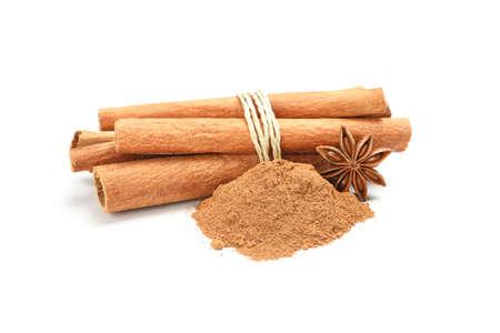Cinnamon sticks, powder and anise isolated on white background 版權商用圖片