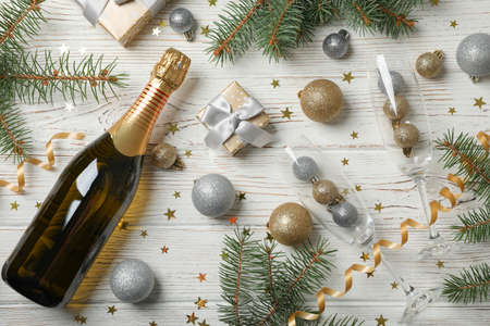 Composition with christmas baubles and champagne on white wooden background, top view 版權商用圖片