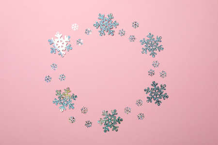 Glitter snowflakes on pink background, space for text
