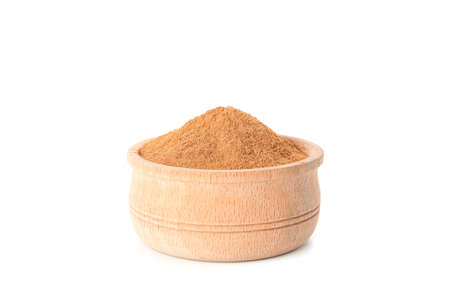 Wooden bowl with cinnamon powder isolated on white background