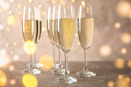 Champagne glasses against blurred lights background. Bokeh effect