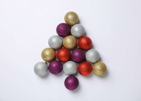 Christmas tree made of baubles on white background, space for text