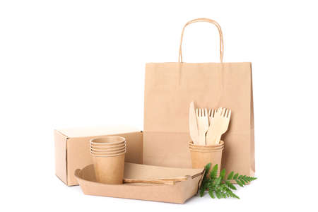 Eco - friendly tableware, plant, paper bag and box isolated on white background 版權商用圖片