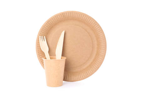 Eco - friendly plate, fork, spoon and cup isolated on white background. Disposable tableware