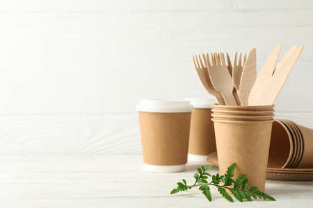 Eco - friendly tableware on wooden table, space for text