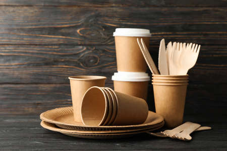 Eco - friendly tableware on wooden background, space for text