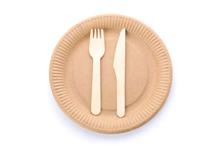 Eco - friendly plate with fork and spoon isolated on white background. Disposable tableware