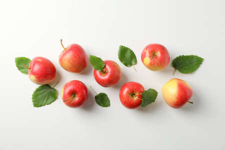 Flat lay with red apples on white background, space for text