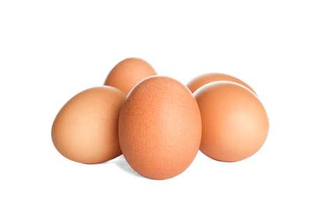 Few raw chicken eggs on white background Stock Photo