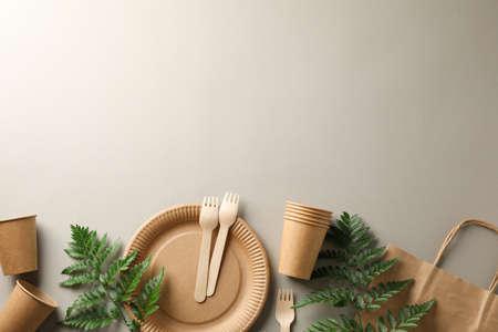 Concept with eco - friendly tableware and plant on grey background, copy space Zdjęcie Seryjne