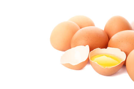 Chicken eggs and half yolk isolated on white background